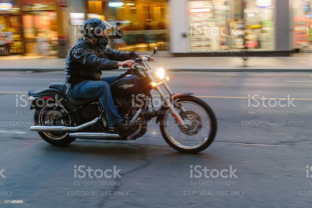 Riding a Harley Davidson on Toronto stock photo