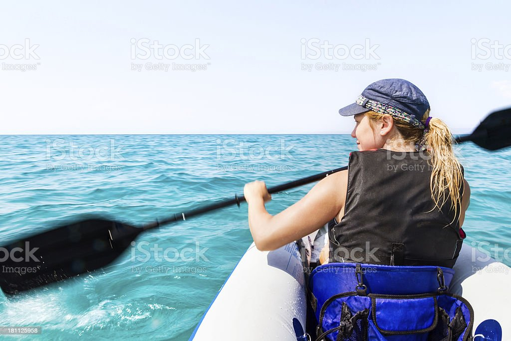 Riding a kayak on the sea royalty-free stock photo