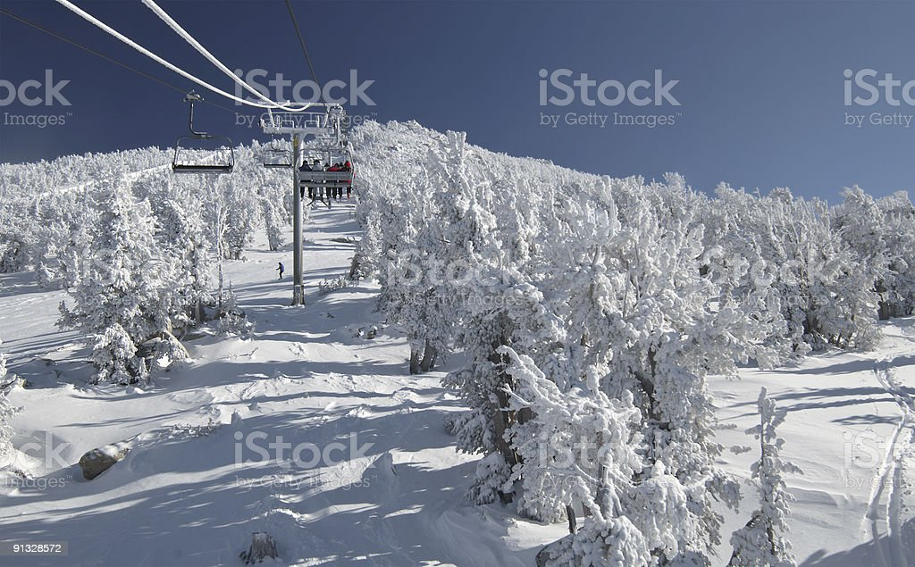 Riding a lift at ski resort 2 stock photo