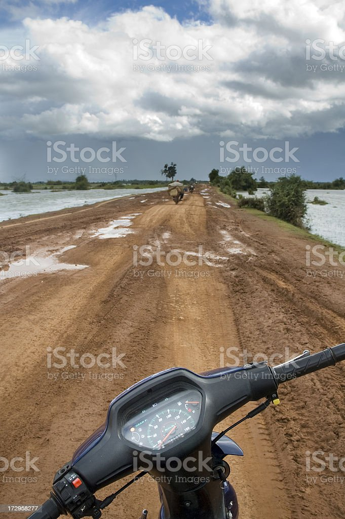 Riding A Motorcycle In Cambodia royalty-free stock photo
