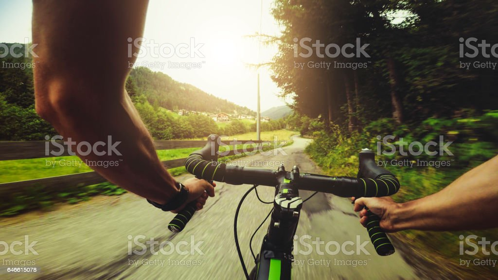 POV riding a road racing bicycle on the mountain stock photo