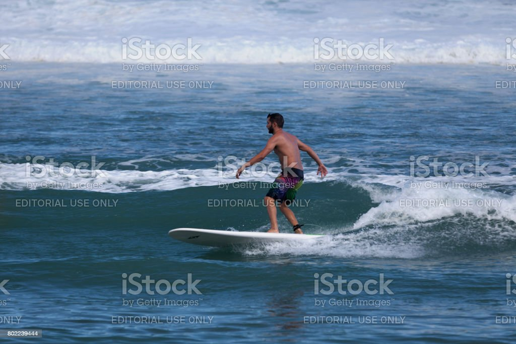 Riding a wave in Reunion Island stock photo