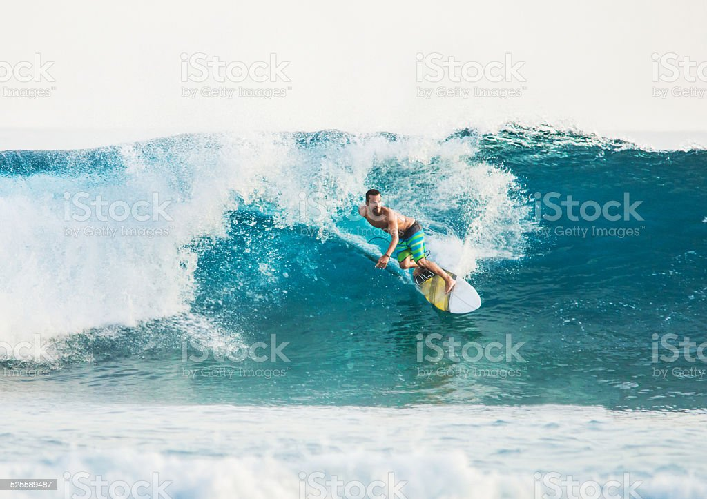 Riding a wave. stock photo