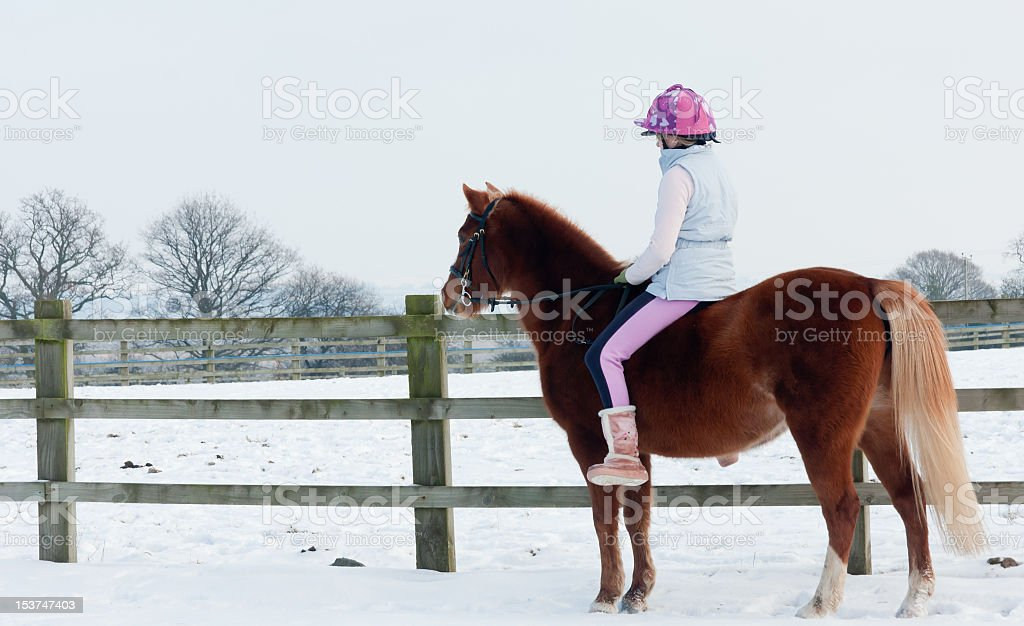 Riding bare back in the snow-girl and pony together. royalty-free stock photo
