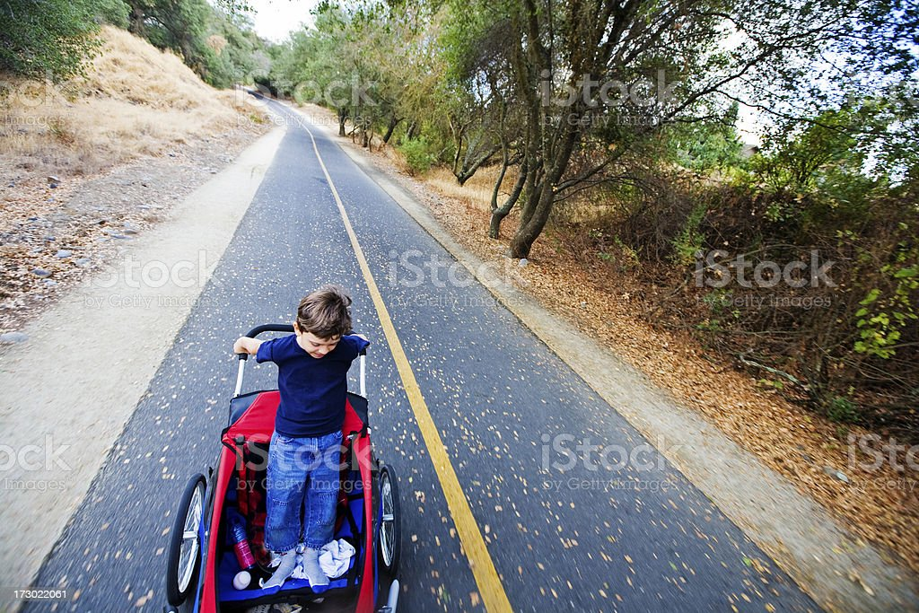 Riding Behind Dad royalty-free stock photo