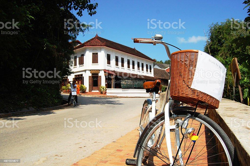 Riding bicycle in  Luang Prabang City at Loas royalty-free stock photo