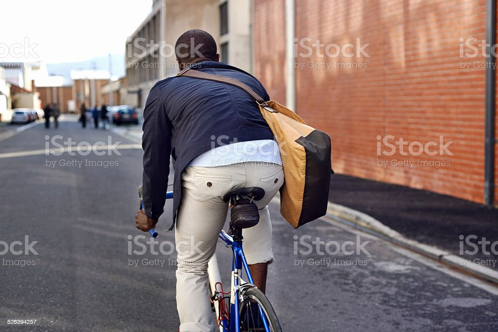 riding bike black man stock photo