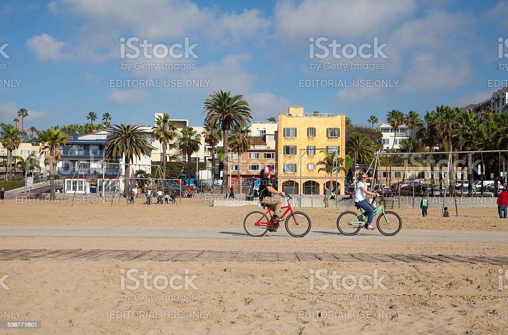 Riding bikes at Santa Monica beach stock photo