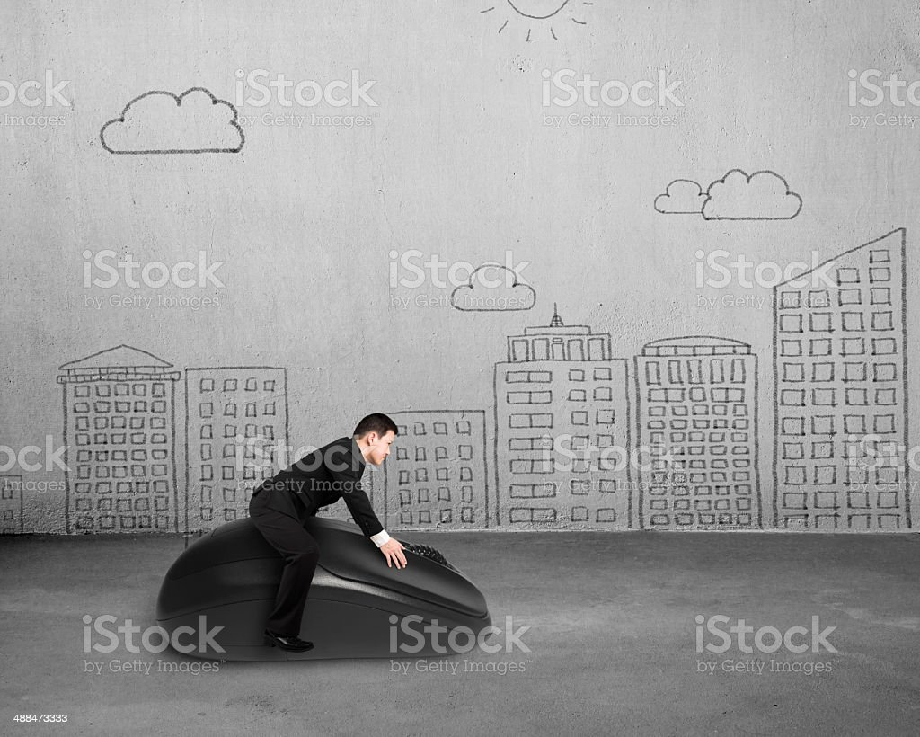 Riding computer mouse with cityscape doodles stock photo