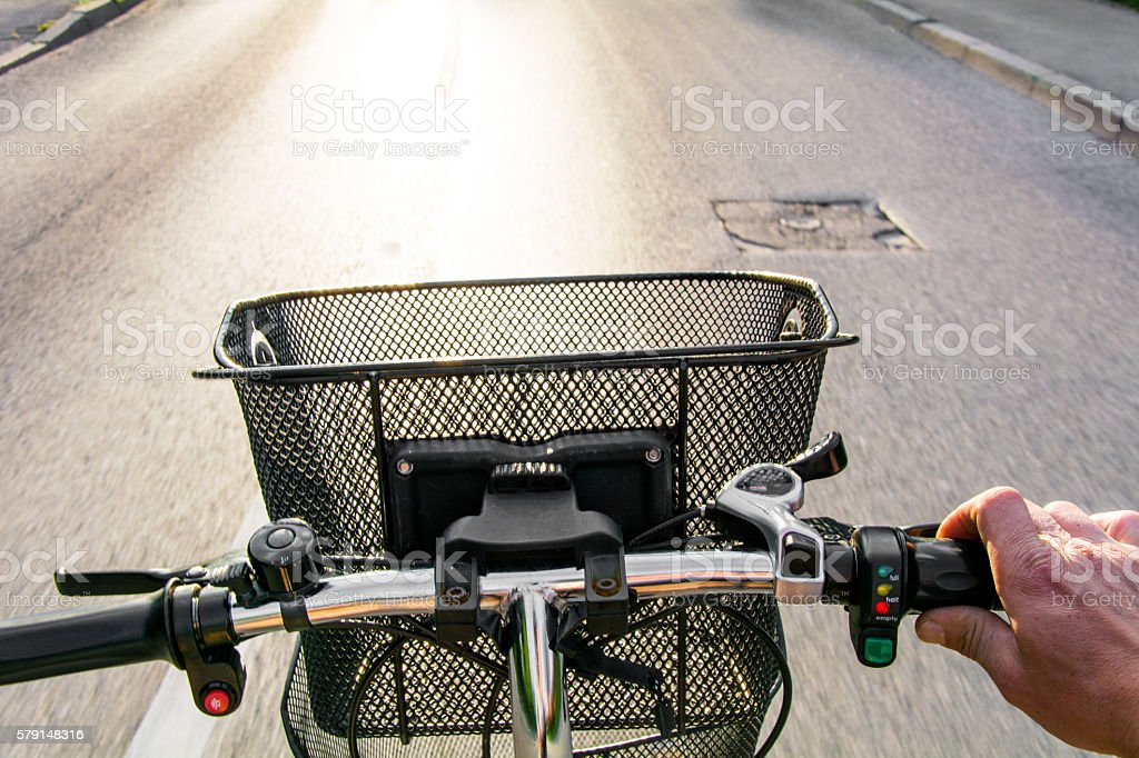Riding electric bike stock photo