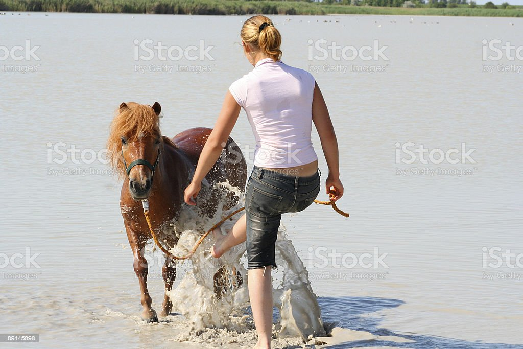 Riding Girl Mould on her little Pony royalty-free stock photo