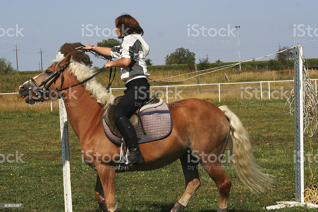 Riding girl tries to close the cordle... stock photo