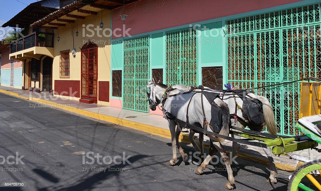 Riding Granada street, Nicaragua stock photo