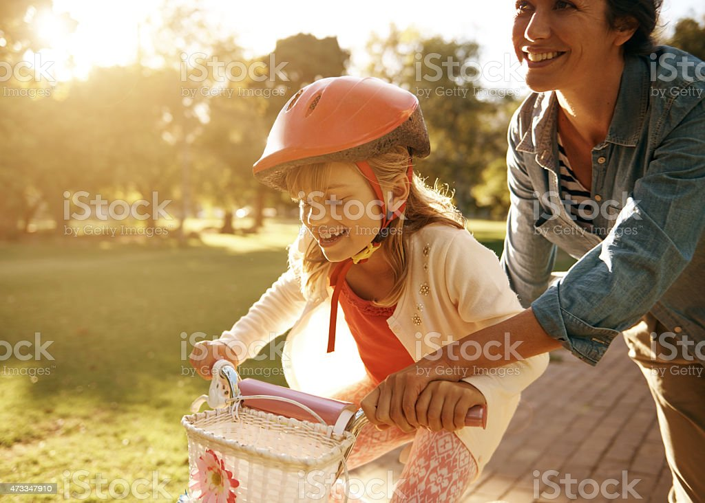 Riding her new bicycle at the park stock photo