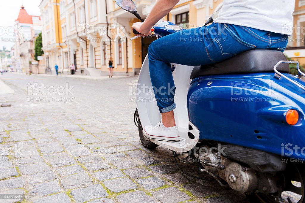 Riding his new scooter. stock photo