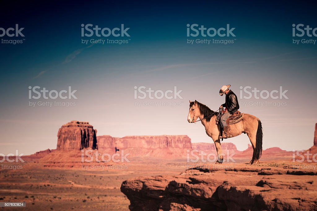 Riding Horse in Monument Valley, Arizona stock photo
