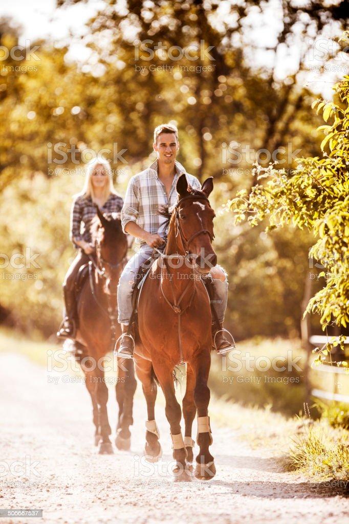 Riding horses. stock photo