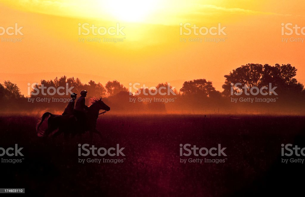 riding in the dawn stock photo