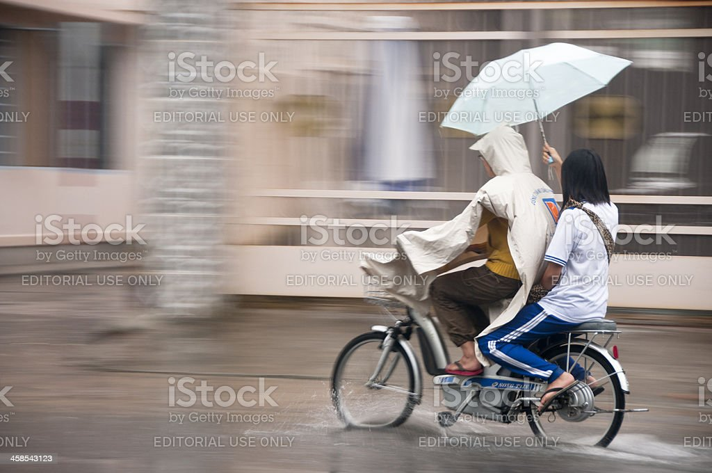 Riding In The Rain stock photo