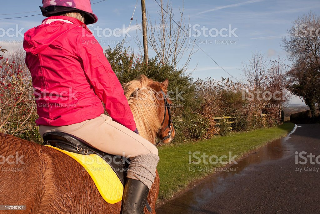Riding in the wet weather royalty-free stock photo