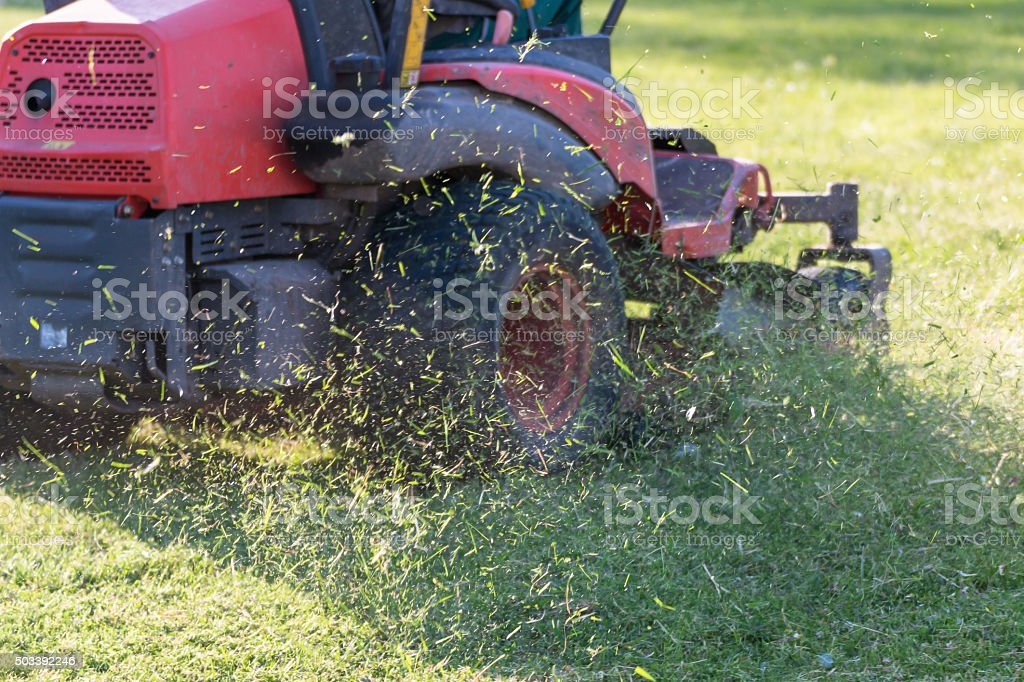 Riding Lawn Equipment with operator stock photo