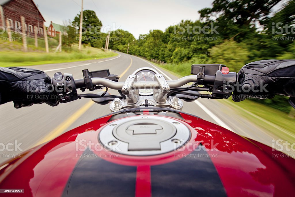 Riding motorcycle on country road stock photo