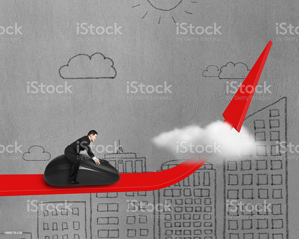 riding mouse on red arrow through cloud stock photo