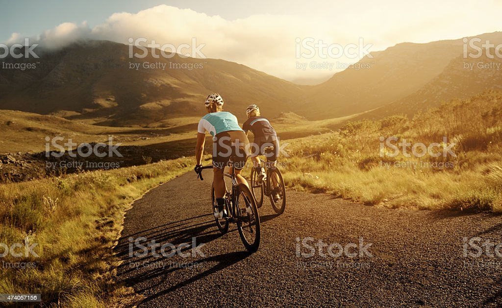 Riding off into the sunset stock photo