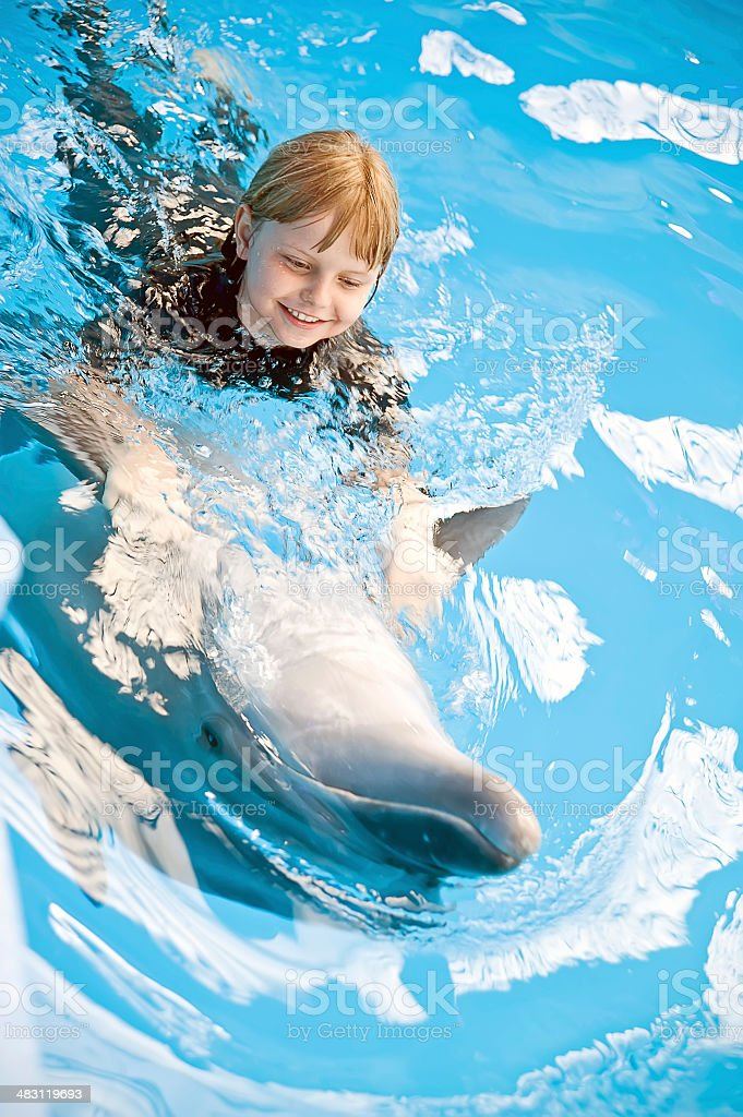 Riding on a dolphin stock photo