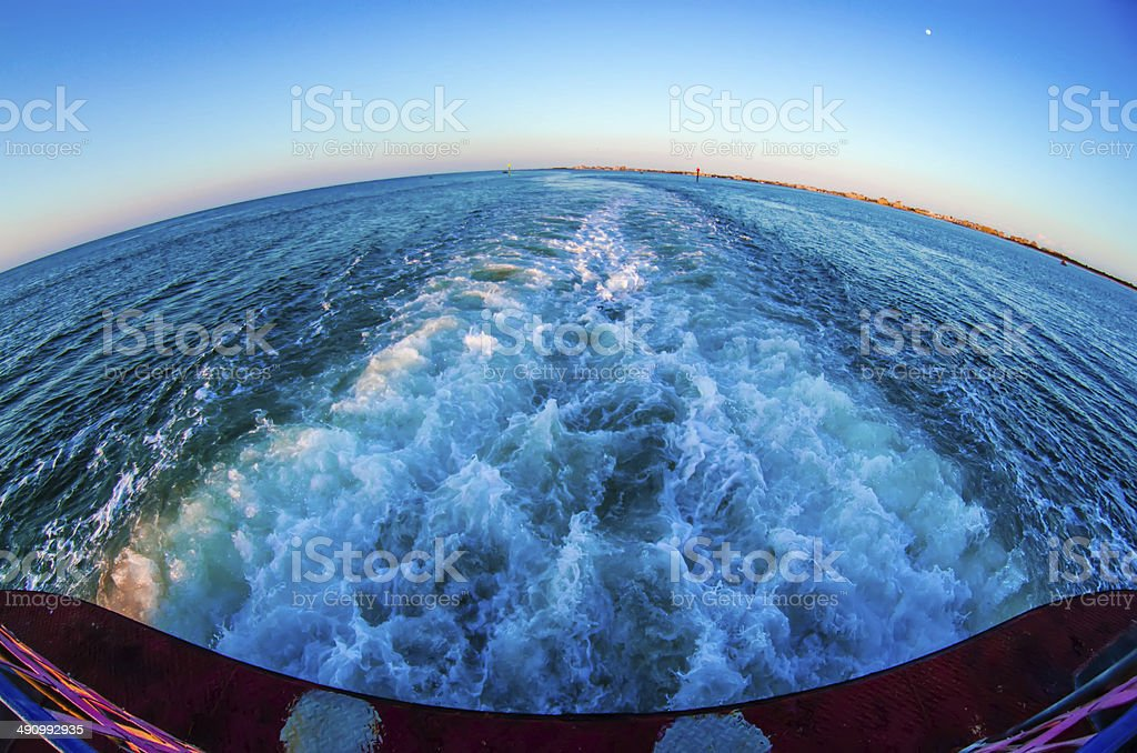 riding on a ferry boat at sunset stock photo