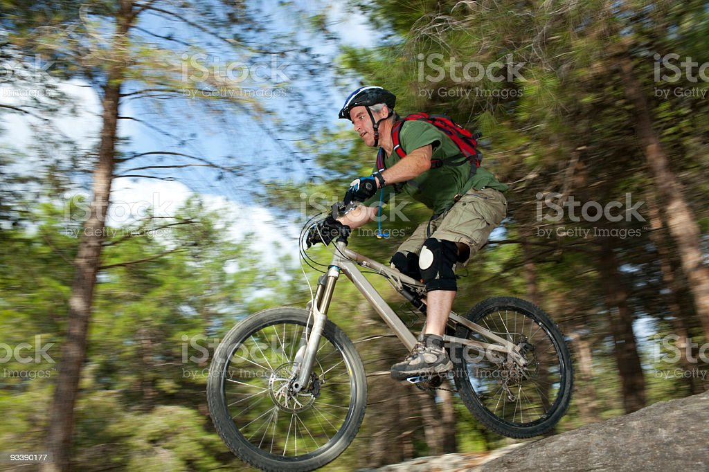 Riding on bike in the forest royalty-free stock photo