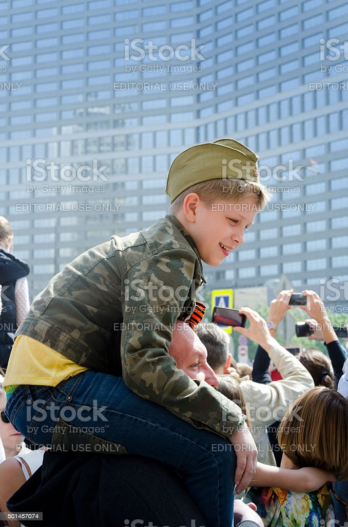 Riding on Dad's Shoulders to See Parade stock photo