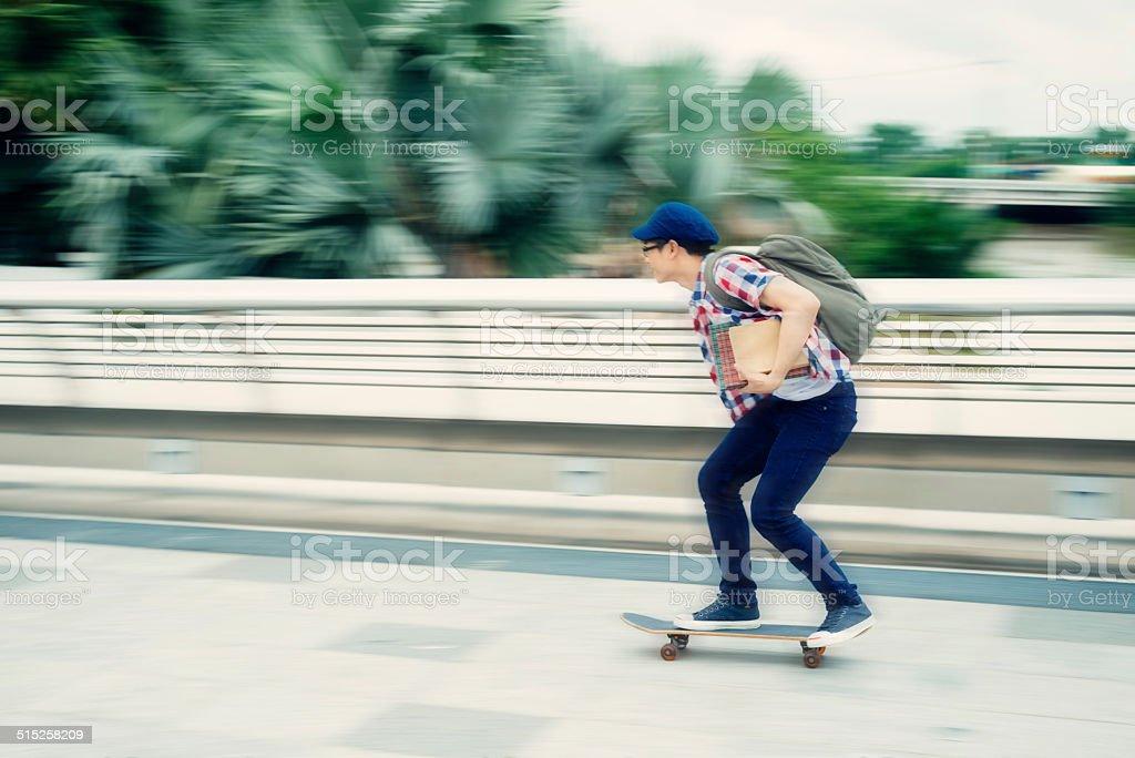 Riding on skateboard stock photo