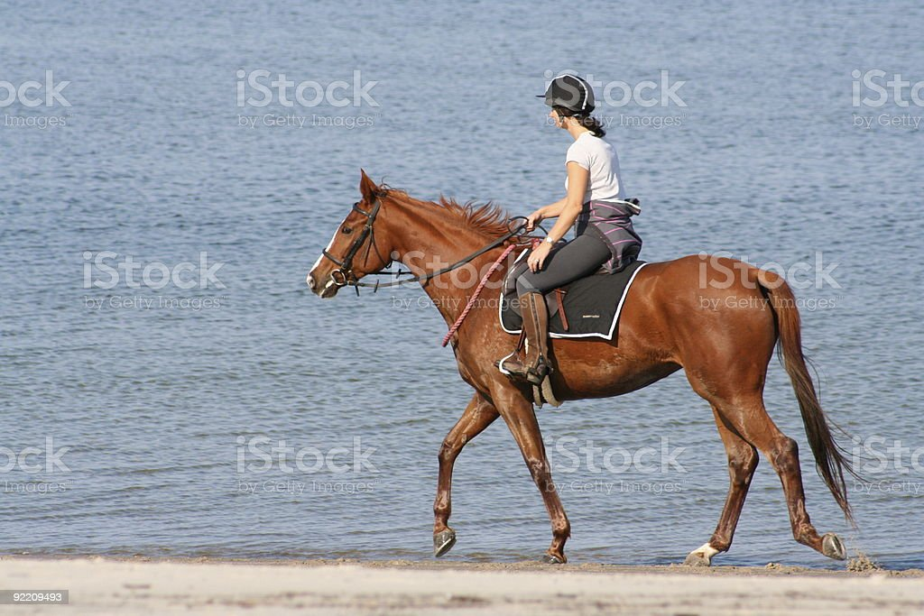 Riding on the Beach stock photo