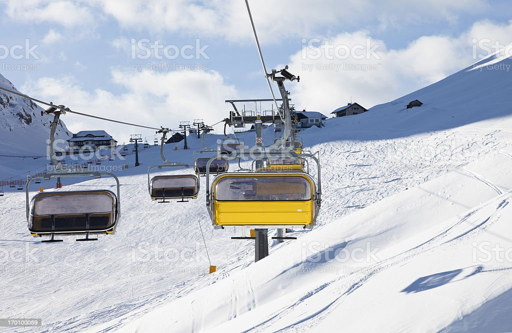 Riding on the chair lift royalty-free stock photo
