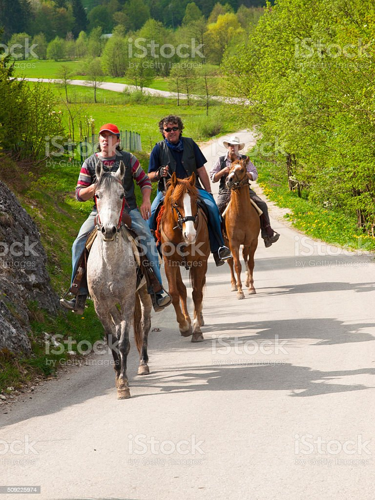 Riding on the rural road stock photo