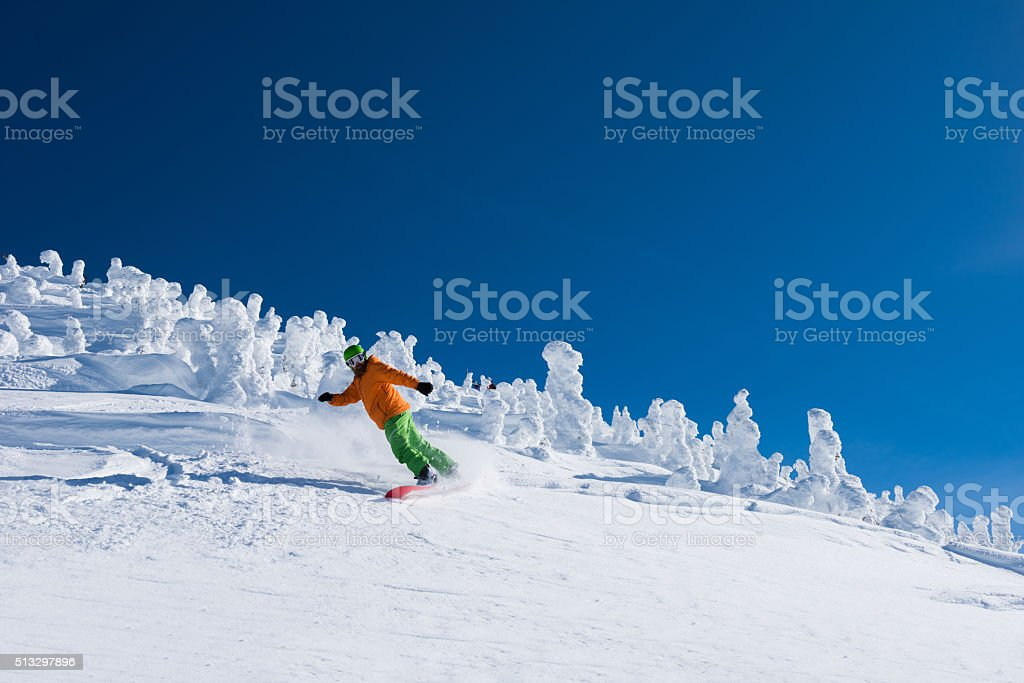 Riding powder at Revelstoke Mountain Resort stock photo