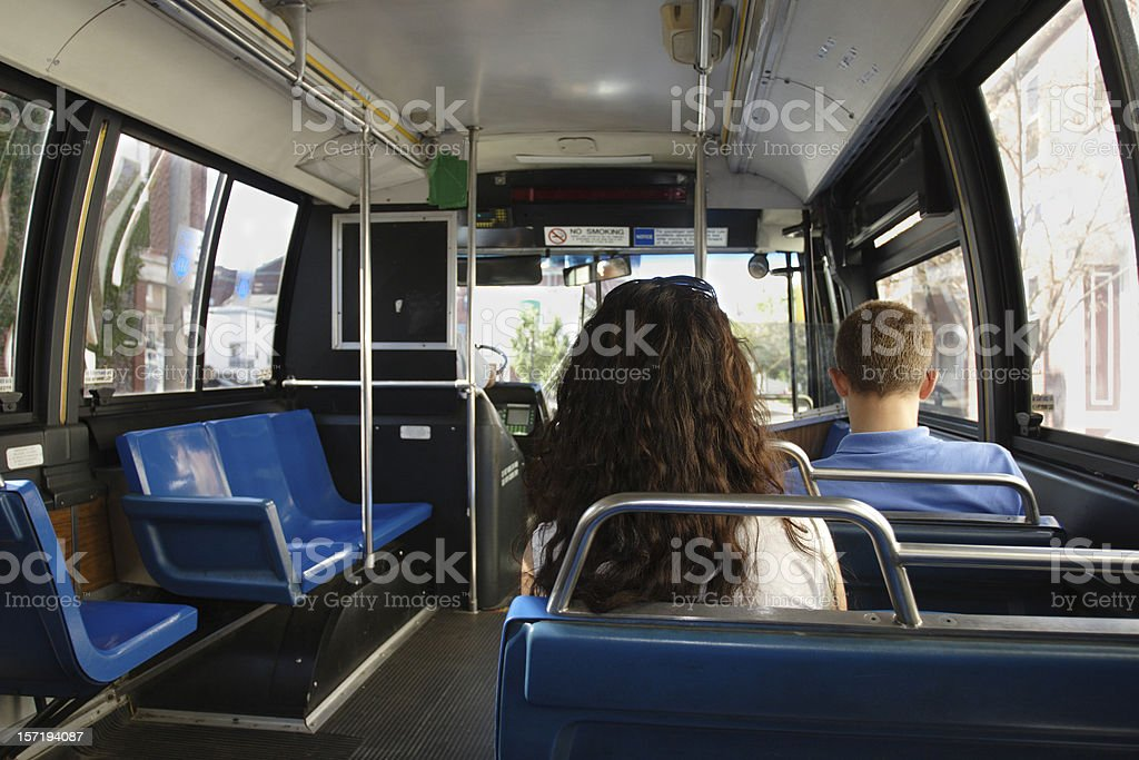Riding public transit - inside a bus royalty-free stock photo