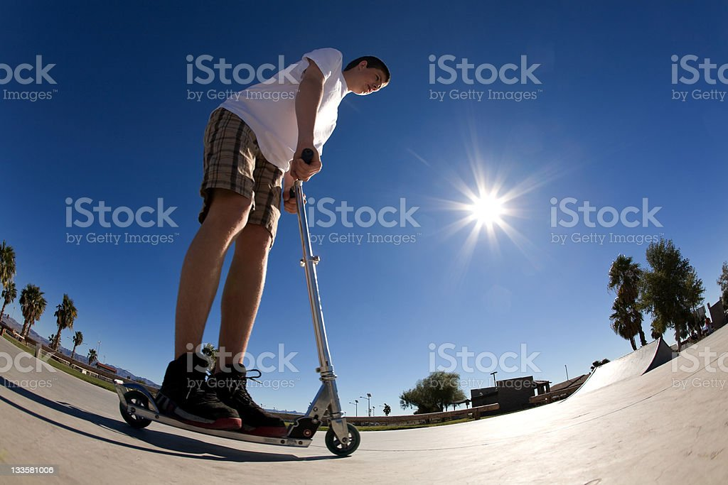 Riding scooter stock photo