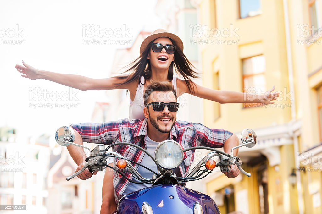 Riding scooter together. stock photo