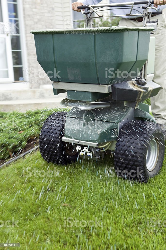 Riding Spreader Applying Fertilizer to Lawn royalty-free stock photo