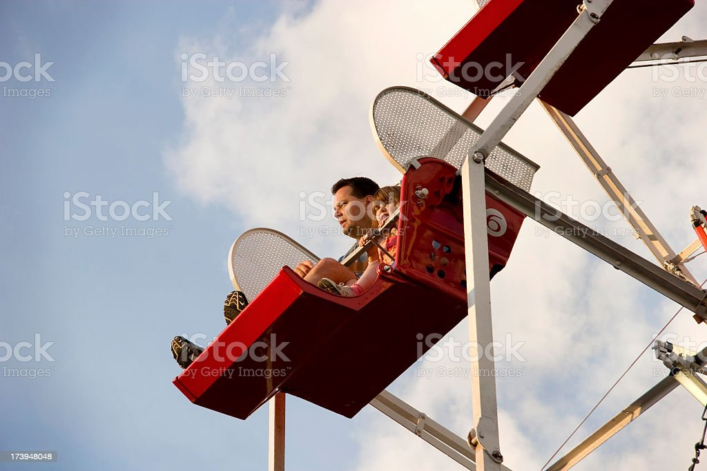 Riding the ferris wheel royalty-free stock photo