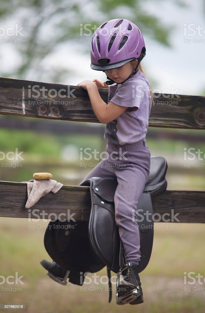 Riding the saddle stock photo