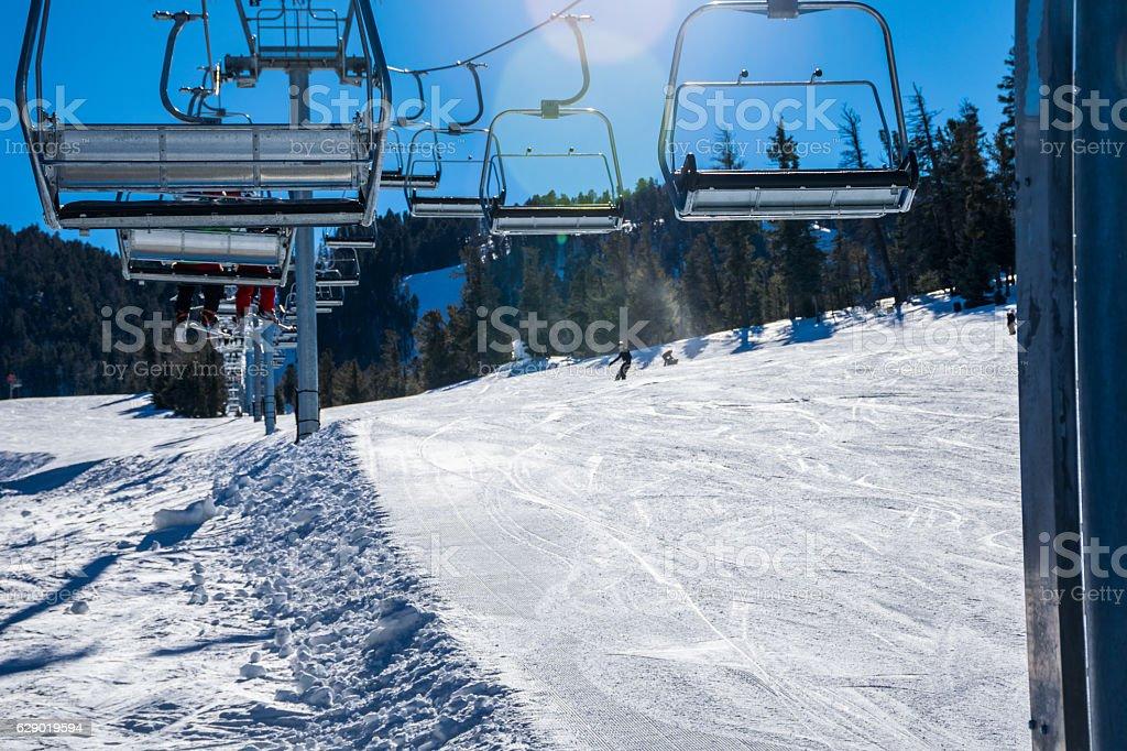 Riding up Ski Lift New Mexico Winter Sports stock photo
