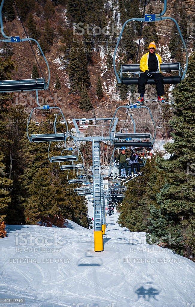 Riding up Ski Lift Steep Mountain New Mexico Winter Sports stock photo