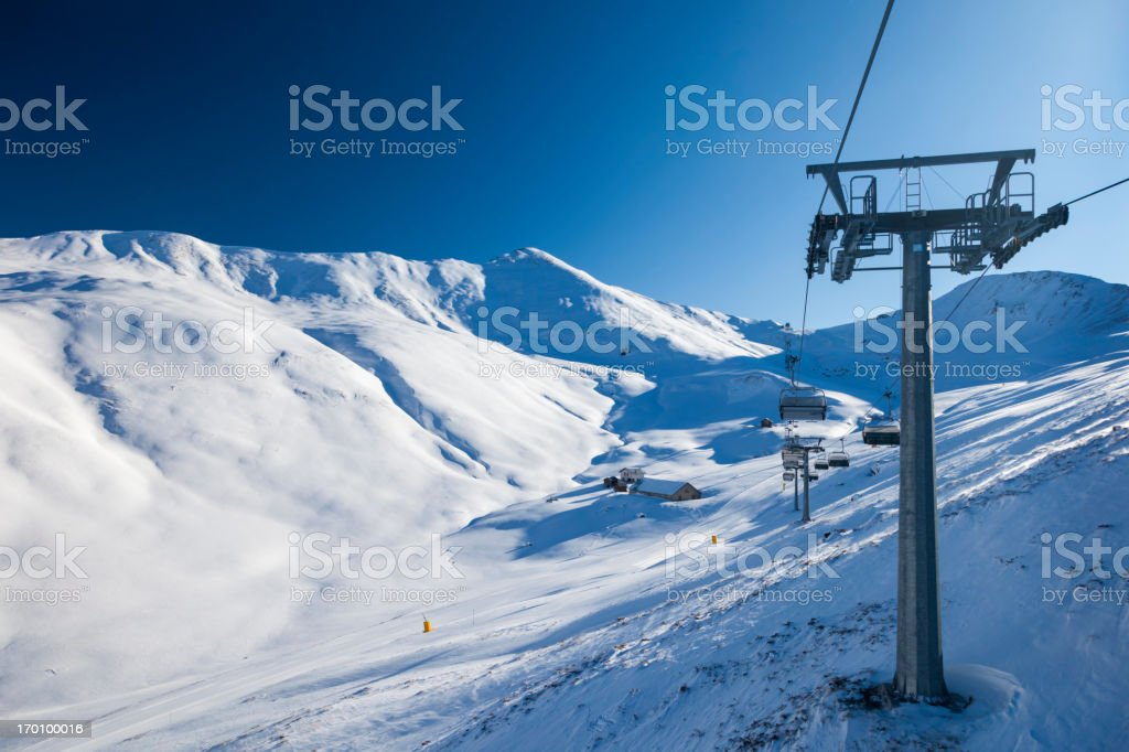 Riding up with the chairlift royalty-free stock photo