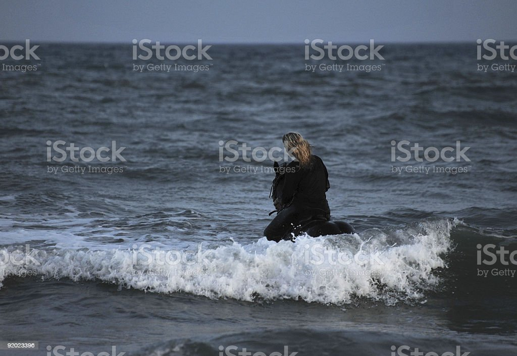 riding woman in sea by night royalty-free stock photo