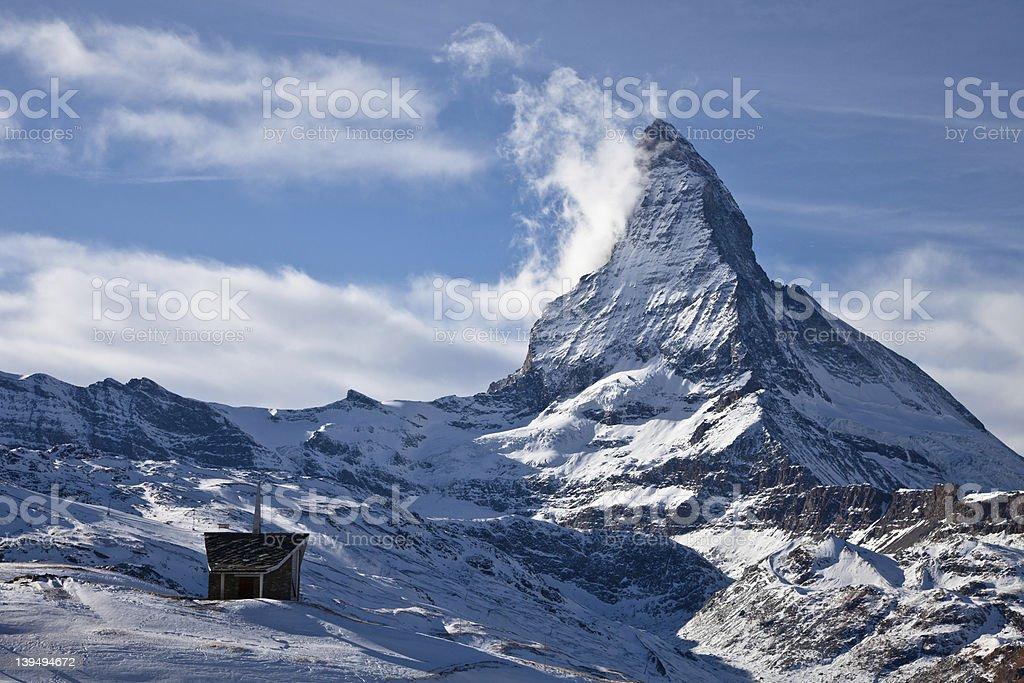 Riffelberg Chapel in the snow below the Matterhorn stock photo
