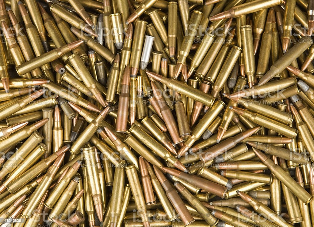 Rifle and Handgun Bullet Background stock photo