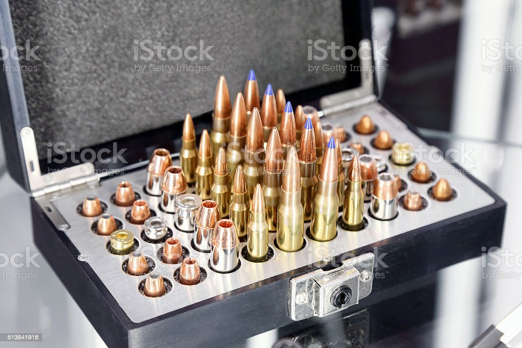 Rifle and pistol bullets stock photo